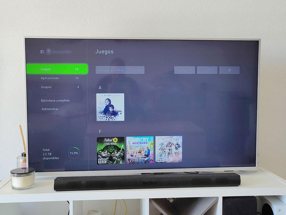 interfax Xbox on silver tv with games installed